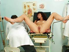 brown hair ready with fixed cage of love at her gynecologist